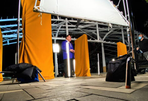 David Baker, president and CEO of the Pro Football Hall of Fame, prepares for the unveiling of the 11 Player Pylons at Centennial Plaza. The pylons were shown for the first time publicly at halftime of the game Thursday night between the Cleveland Browns and Cincinnati Bengals.